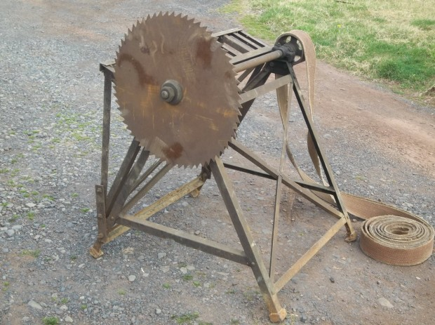 vintage bucksaw — my father used a similar blade to make a seeder for our crops. It wasn't exactly safe, but it worked!